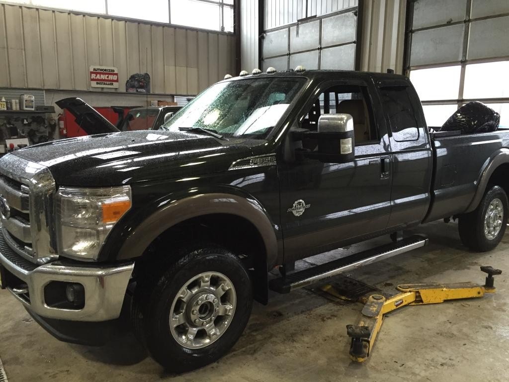 2015 Ford F-350 With Ready Lift Leveling Kit XD Spy Wheels and Nitto Trail Grappler Tires